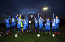 Young players from St Cuthbert Wanderers celebrate financial assistance from Banks Renewables