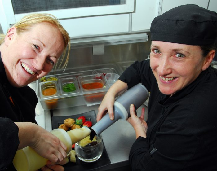 Chefs Suzannne O'Connor and Rachel McPhail cooking up a storm for Tigerlily's new, delectable summer menu.
