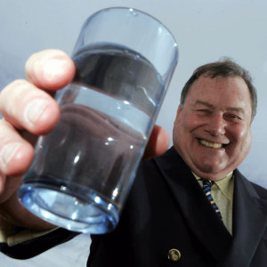 Scottish PR photography JIm Panton headshot holding glass of water