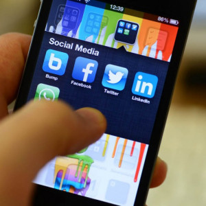 Digtal PR and social media in action on a mobile phone