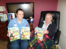 Neil McNeil celebrating his 104th birthday with his daily helping of porridge