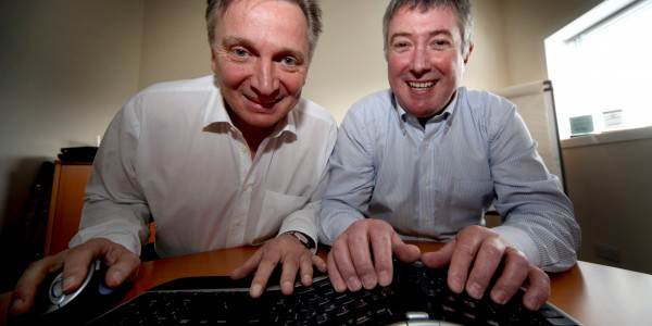 Euro Business Directors in front of keyboard