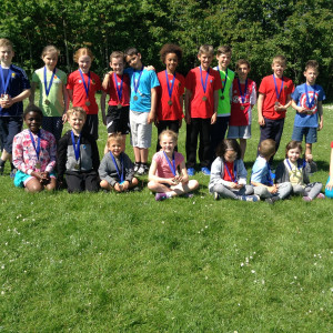 Children celebrating sports day with medals