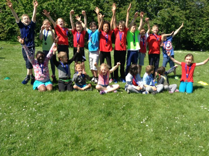 Children celebrating sports day and donation from Cala Homes