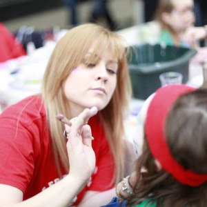 An image of a child getting their face painted at Gyle Family Fun Day