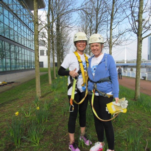 A photo of Heather and sister Nicola wearing harnesses and hardhates