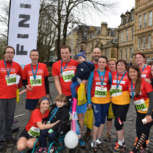 An image of marathon runners at the end of their race gathered with Ruby