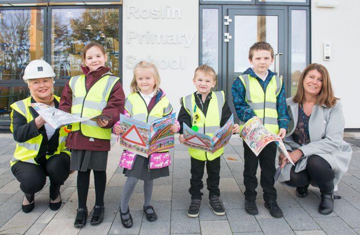 School Children Pose Alongside Head Teacher and Laura Cromerford for Edinburgh PR Experts Story