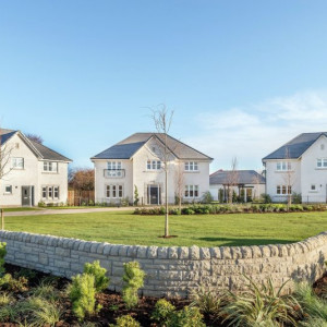 Property PR photograph of CALA Homes Castle Bay in Dunbar - three large detached homes within expansive gardens