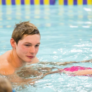 PR photograph of Duncan Scott delivering a swimming lesson at Tollcross International Swimming Pool in Glasgow at
