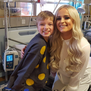 Charity PR photograph of Caitlyn Vanbeck and a young girl, Lily Douglas, at the Royal Hospital for Sick Children in Edinburgh.