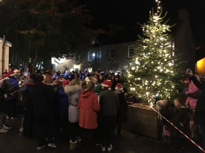 Residents from Balerno gather to celebrate the annual Christmas light switch on in a Propery PR image