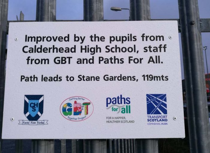 A new sign along a once forgotten path, reopened with help from Paths for All, is shared in a charity PR image