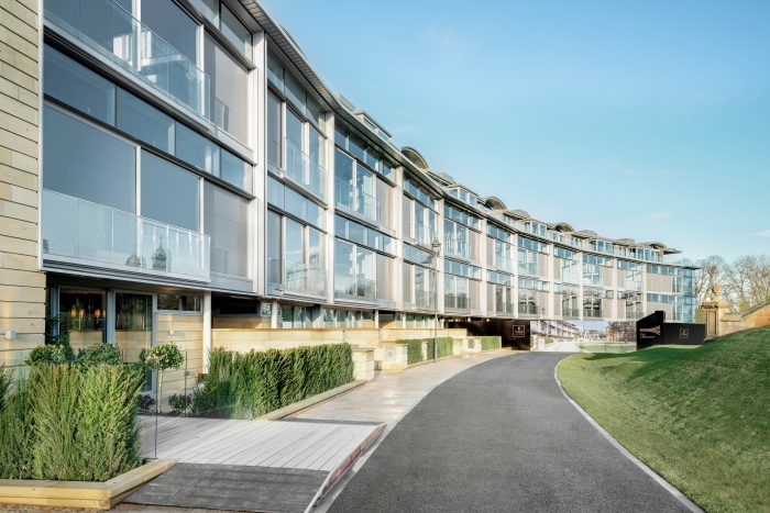 Property PR photograph of CALA Homes The Crescent - a sweeping curve of glass fronted contemporary apartments.