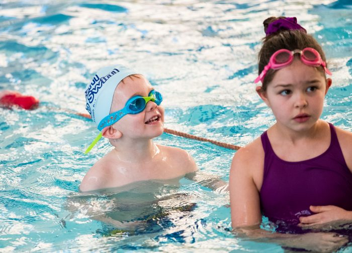 Scottish PR photograph of children laughing in the swimming pool.