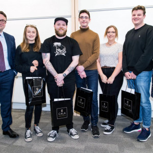 Winners of the CALA Homes Student Partnership Award appear in a property PR photo