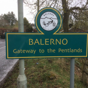 "Image shows Balerno's new green and yellow welcome signage, along with ""Gateway to the Pentlands"" - installed thanks to CALA Homes"