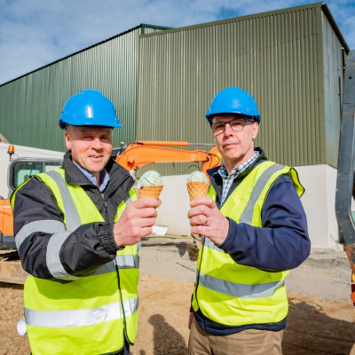 Food and Drink PR photo of Mac Mackie and Gerry Stephens eating green ice cream to celebrate the announcement of Mackie's of Scotland's new £4m refrigeration system