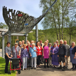 Charity PR photography of successful Cairn Community Fund group