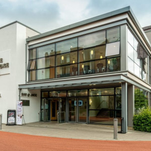 Exterior image of the John McIntyre Conference Centre (JMCC) at the University of Edinburgh's Pollock Halls Campus, a purpose-built venue and important part of Edinburgh First's Conferencing business