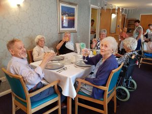 Pensioners at Bield's Glebe Court celebrate the developments 25th anniversary in a charity PR image