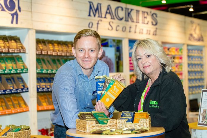 Food and Drink PR photo of Mackie's of Scotland celebrating securing a listing for their chocolate with ASDA. Photo shows Stuart Common (Mackie's Sales Director) and Yvonne McArthur Asda Buying Assistant with chocolate