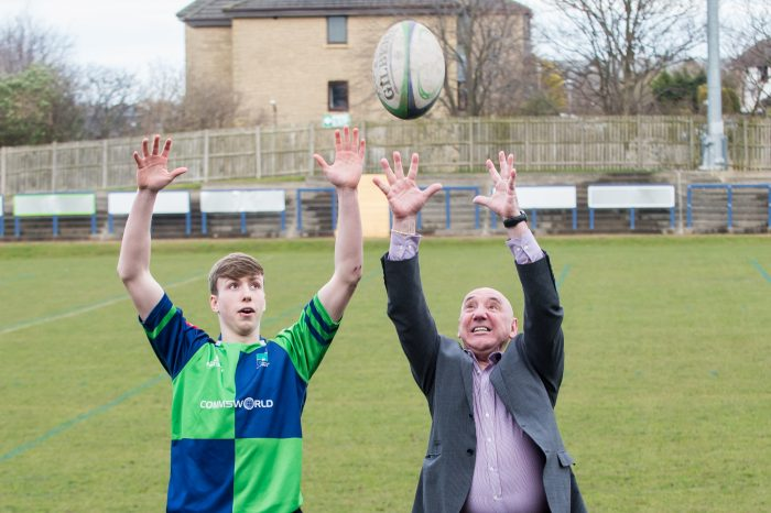 Photograph of Ricky Nicols, Chief Executive Commsworld with Boroughmuir Rugby Team