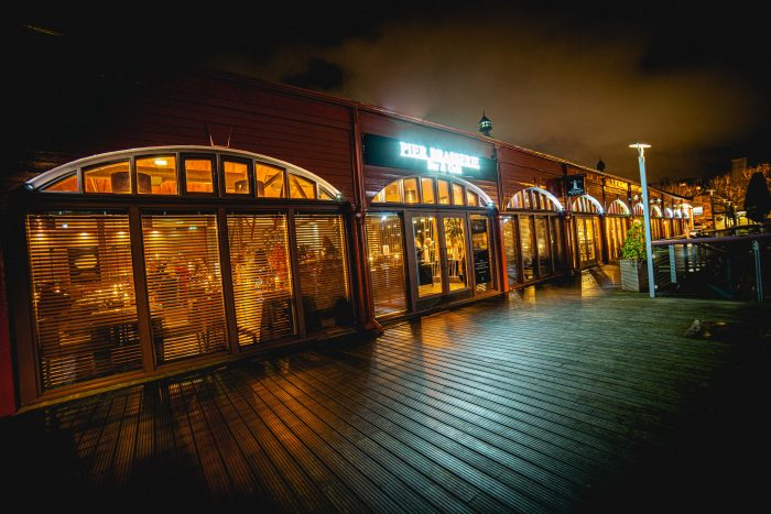 Exterior image of Pier Brasserie taken in the evening | food and drink PR