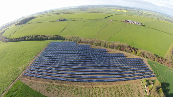 Drone image shows panoramic of Mackie's solar farm set against the rolling Aberdeenshire hills