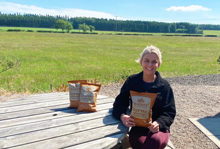 Sally Taylor of Mackie's Crisps at the Taylor Farm in Perthshire holding a pack of Lorne Sausage and Brown Sauce Crisps