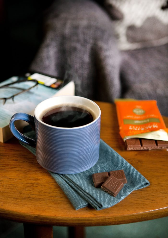 Food and Drink PR photography Mackie's of Scotland new flavour bar on table next to cup of tea