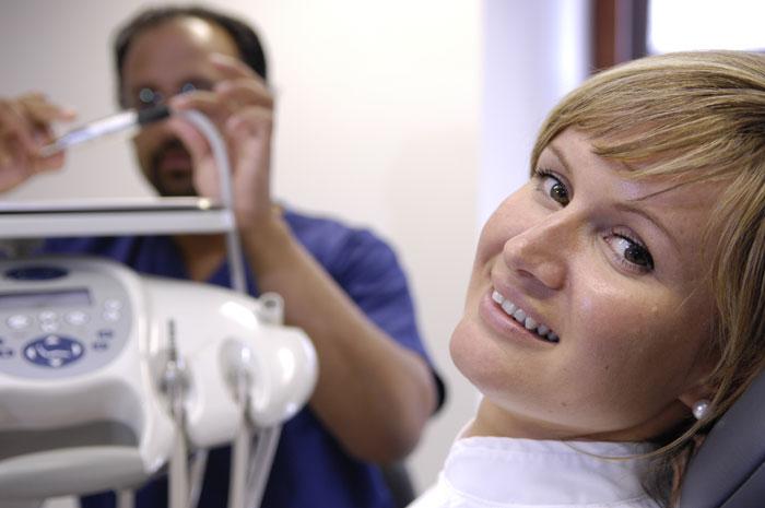 Dental PR photos of cosmetic dentist at work