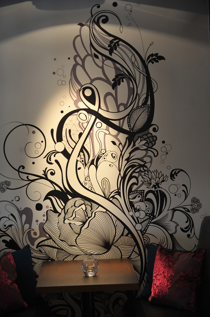 Hyde Out's distinctive art work on booth walls