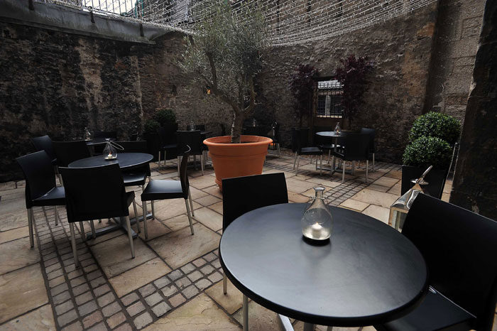 The courtyard of Divino Enoteca is captured in a food and drink PR image