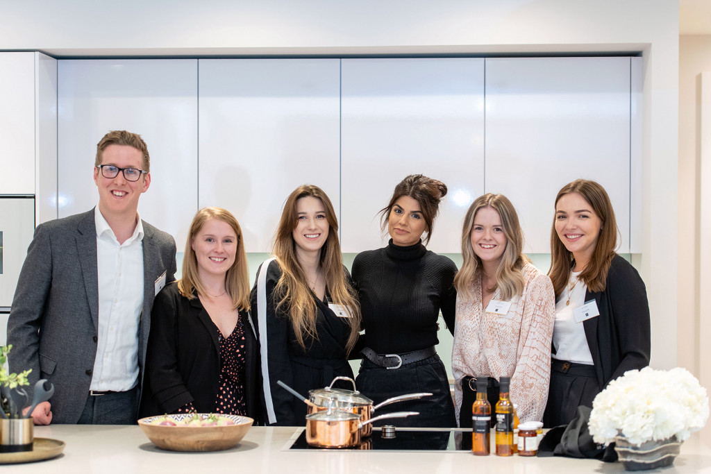 The Holyrood PR team pose for a photo with Ruby at an influencer event at CALA's most upmarket development, The Crescent