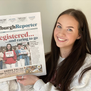 PR Photograhy, Lara holding April edition of The Edinburgh Reporter.