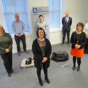 Professional PR photography group shot of staff at Gill Financial, Ownership Associates UK
