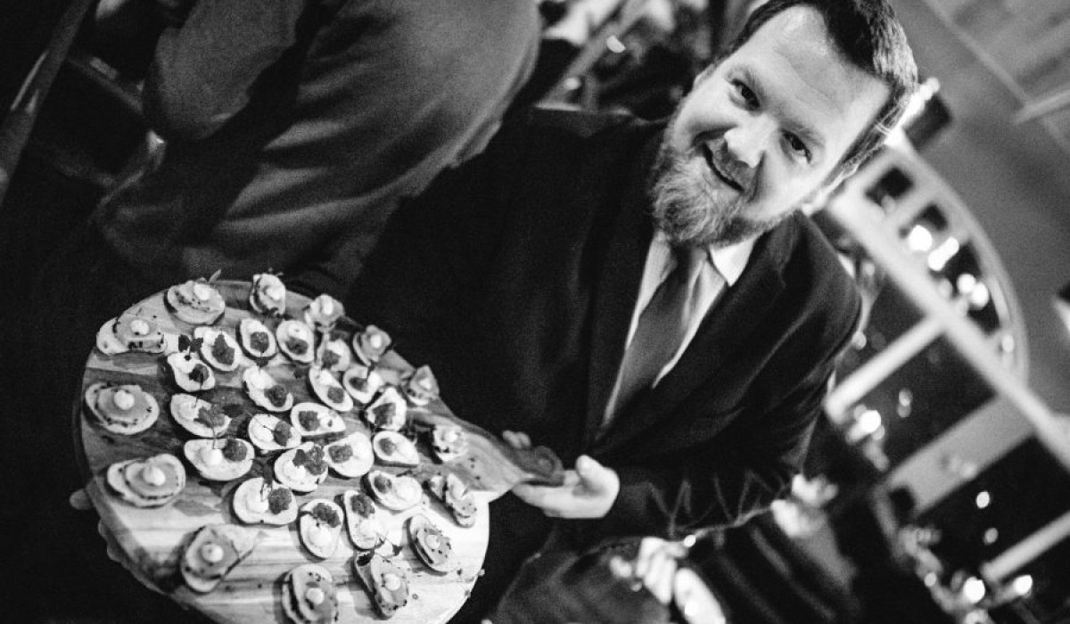 Mark presenting an array of canapes at the Pier Brasserie launch event