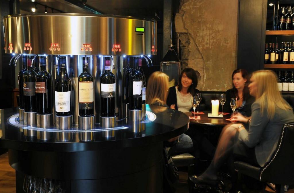 Customers are captured enjoying a drink at Edinburgh wine bar Divino Enoteca in a Bar and Restaurant PR image