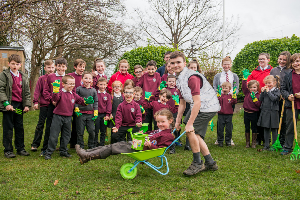 Children from St Margaret's RC Primary School with gardening equipment donated by CALA Homes