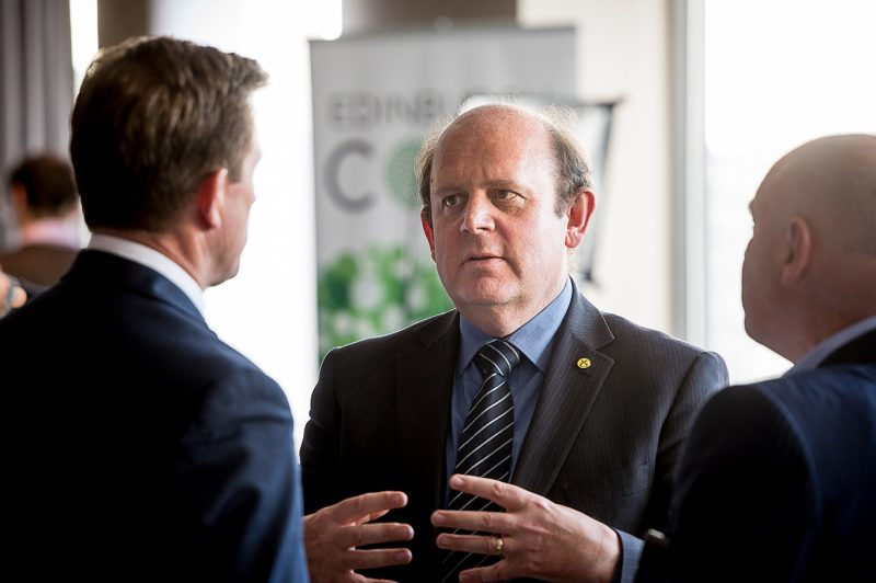 Councillor Frank Ross in a tech PR photo in conversation at CityFibre and Commsworld launch event