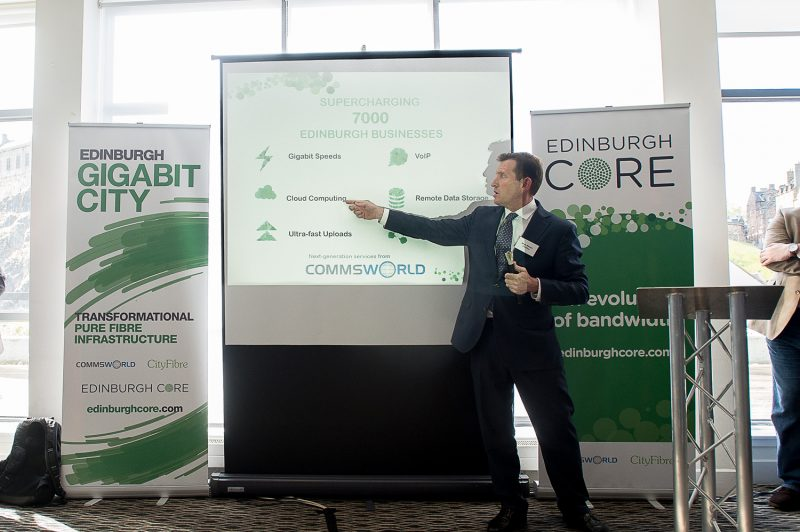 Greg Mesh captured in a tech PR photo of his presentation at CityFibre and Commsworld launch