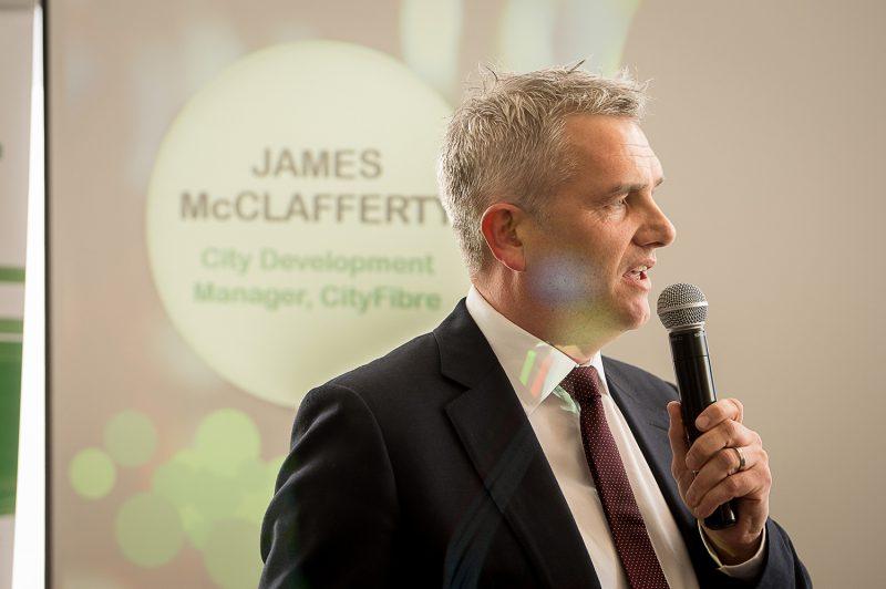 A tech PR photo of James McClafferty, CityFibre City Development Manager talking at the CityFibre and Commsworld launch event