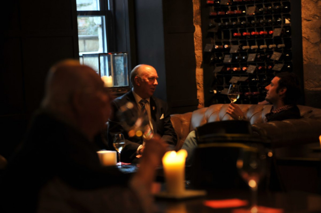 Patrons of Edinburgh's Divino Enoteca are captured in a food and drink PR image