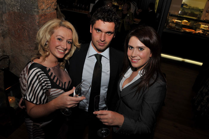 Three guests at the launch of Edinburgh's Divino Enoteca are shown enjoying sampling the extensive wine list on offer