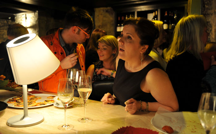 A women is seen ordering at the bar in a PR photograph taken at the launch of Edinburgh's Divino Enoteca