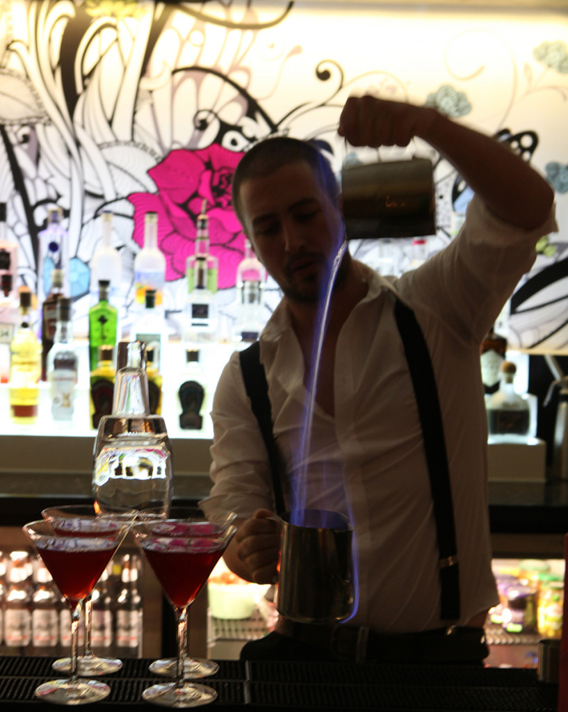 Mixologist making flaming cocktail at  Hyde Out