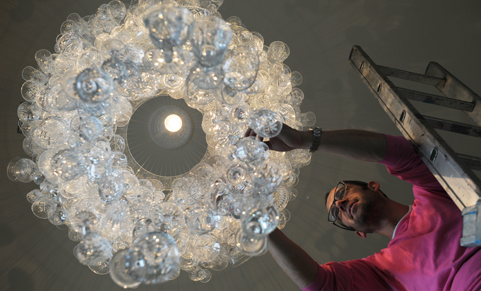 Craftsman with wine glass chandelier at Hyde Out style bar in Edinburgh,  Scotland