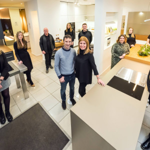 Professional services PR photography Kirsten and Ian Robeson with Cameron Interiors team, Ownership Associates UK