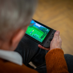 social care PR photography Professor Pompa playing on Nintendo Switch, Cramond Residence